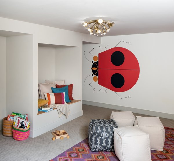 Kids playroom with Charlie Harper wallpaper.