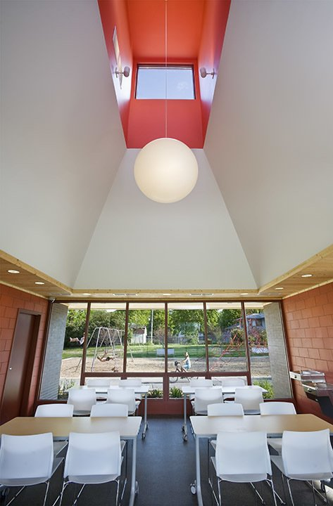 Interior of the park building.  A modern and fresh approach to a small public park in Minnesota. by U+B