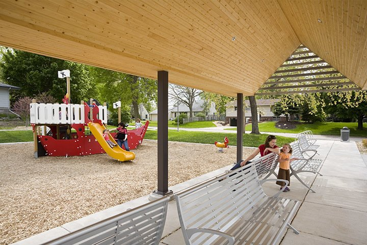 Shade structure adjacent to park playground.  A modern and fresh approach to a small public park in Minnesota. by U+B