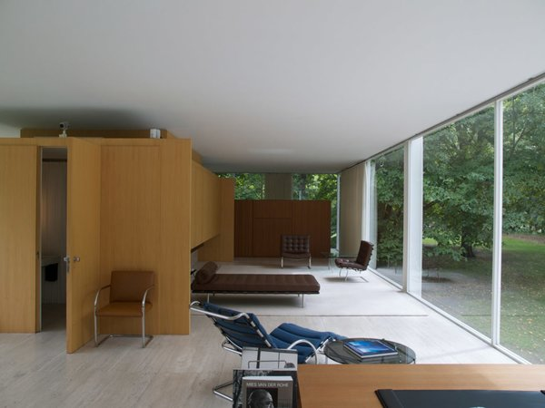 Modern home with back yard, landscape lighting, trees, wood fence, living room, bench, chair, and travertine floor. Hold it Home Photo  of Hold it Home