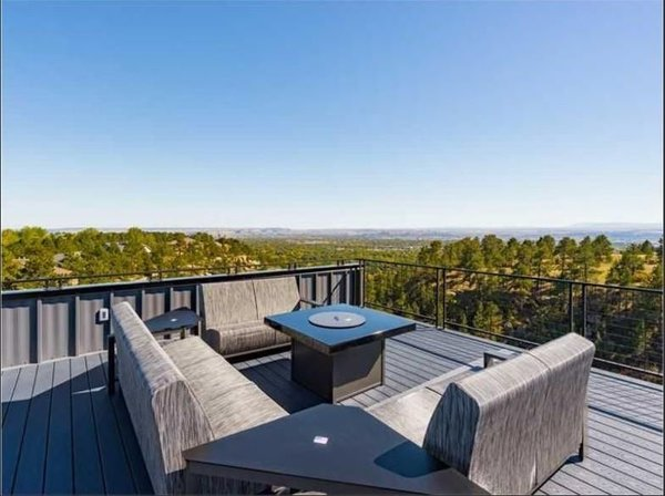 Roof top patio complete with fire pit and 8 person hot tub Photo 5 of Zimmerman Place modern home