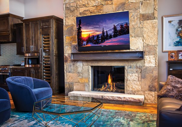 Moving onto the living room you are greeted by a larger than life stone hearth featuring a Modore 100H by Element4. Photo 4 of Breckenridge Bliss modern home