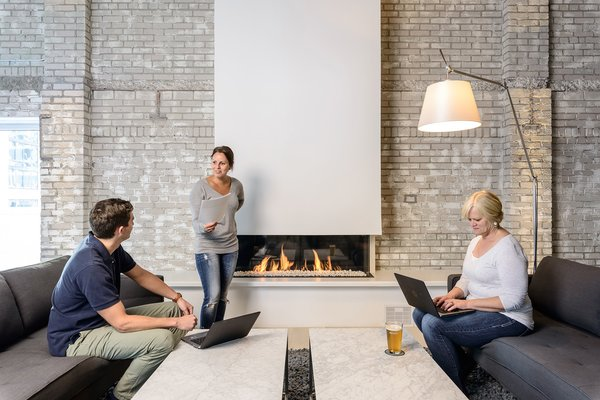 Modern home with gas burning fireplace and shed & studio. A space to collaborate. Photo  of Mithun Agency