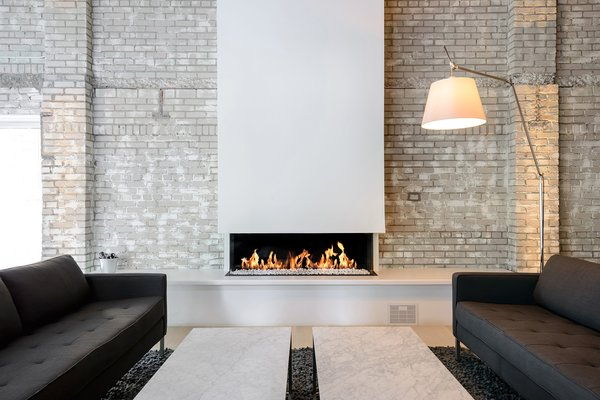 Modern home with living room and gas burning fireplace. Trisore 140 by Element4; distributed by North American Retailer, European Home. Photo 5 of Mithun Agency