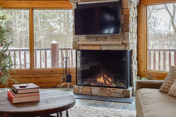 Modern home with living room and gas burning fireplace. A contemporary twist on a classic fireplace. Photo 3 of Northwoods Log Cabin