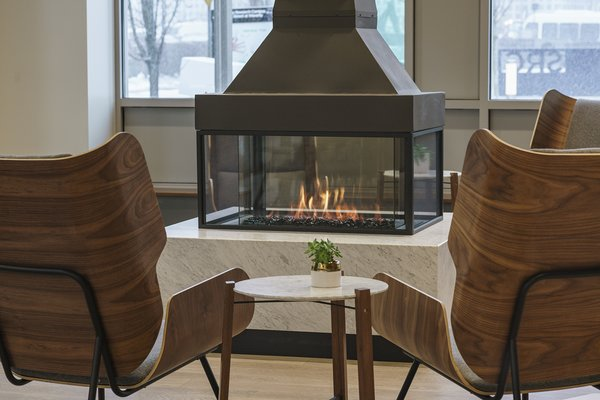 Modern home with dining room and gas burning fireplace. The dancing flames of the 360 fireplace by Element4. Photo 5 of Flour Bakery