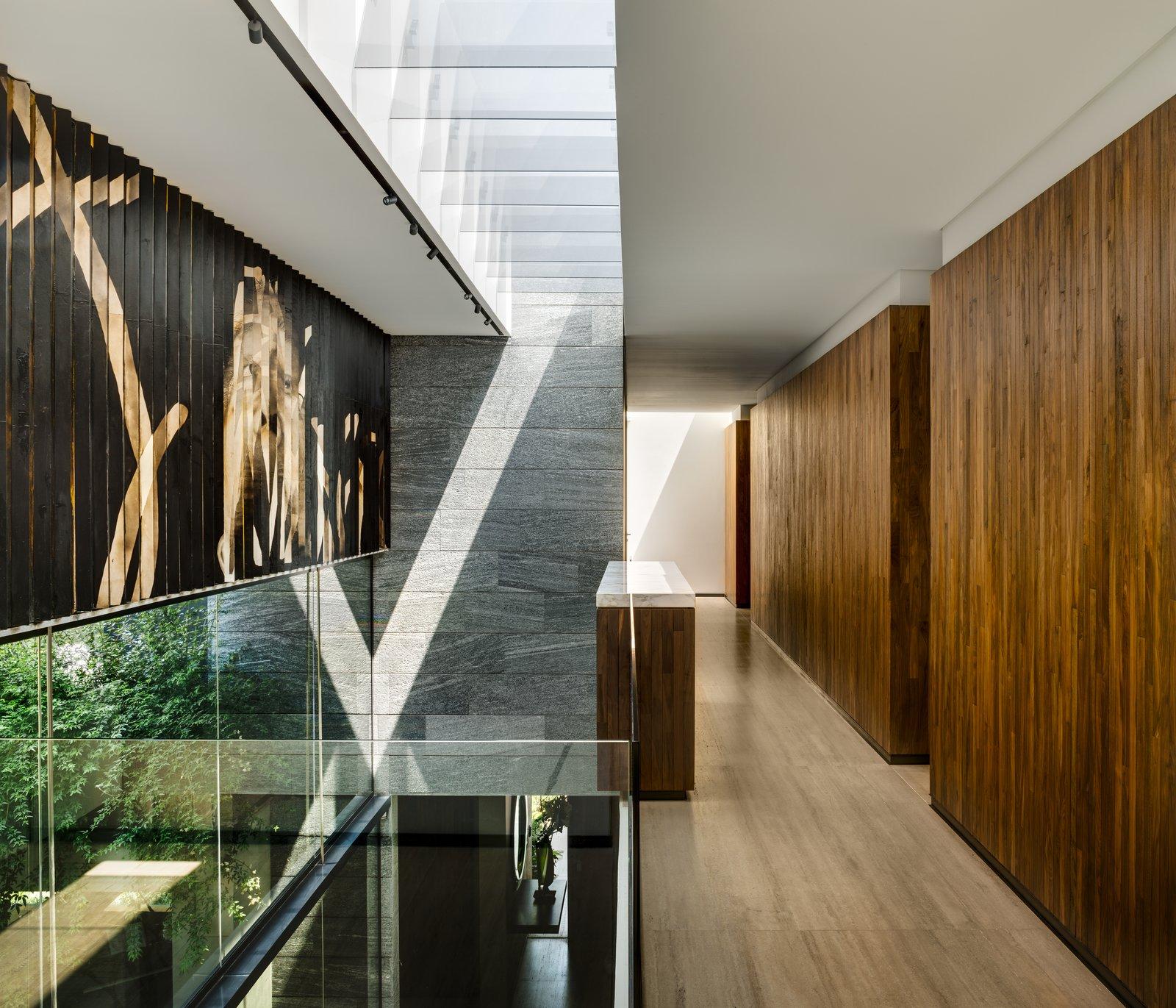 Tagged: Hallway and Light Hardwood Floor.  Casa O Cuatro by Migdal Arquitectos