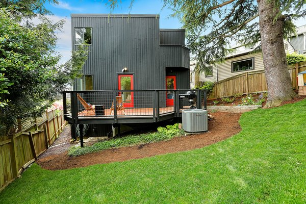 The slope of the Monolith's backyard gives it a bit of a treehouse effect. Photo 4 of The Monolith modern home