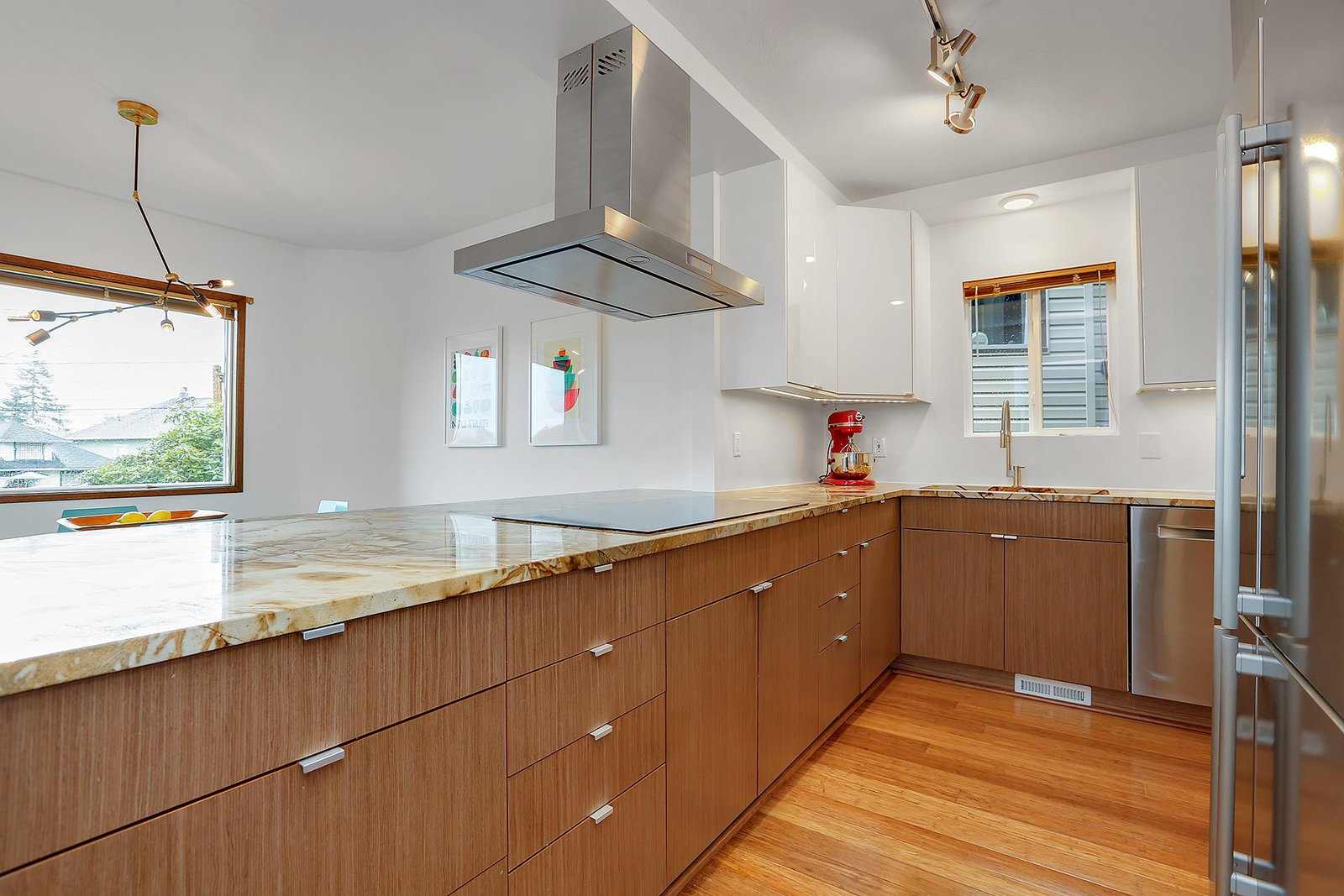 The kitchen features quartzite counter tops and custom cabinets by Semihandmade  The Monolith by Benita Hsueh Baker