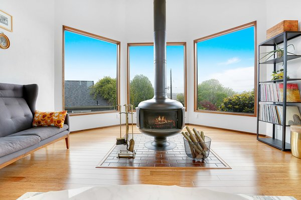 Original drum fireplace and views of shipping canals. Photo 5 of The Monolith modern home
