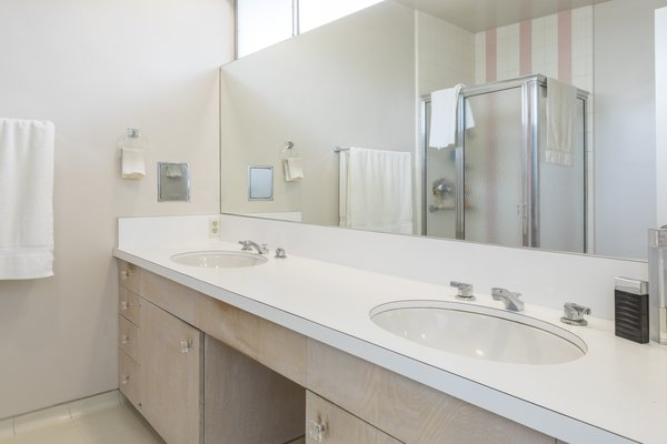 Modern home with front yard, back yard, swimming pool, bath room, enclosed shower, and undermount sink. Master Bath Photo  of Mid Century Modern Time Capsule in Palm Springs