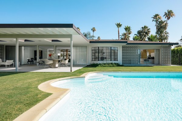 Modern home with outdoor and large pool. Poolside Photo 3 of The Clarke Residence
