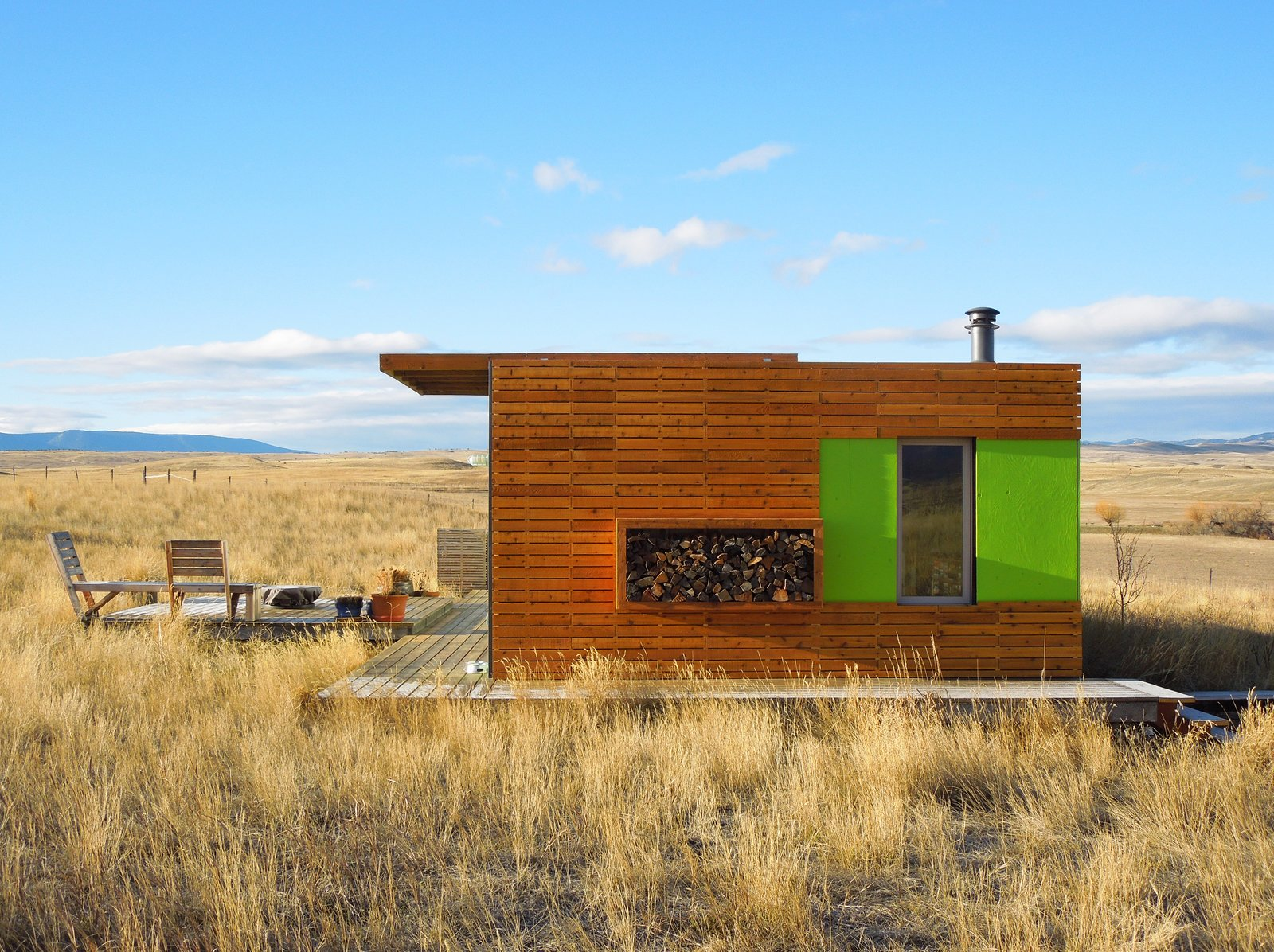 Side Elevation Tagged: Exterior, House, Metal Roof Material, Metal Siding Material, and Wood Siding Material.  Little Box on the Prairie by Ty Kelly
