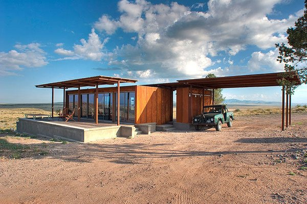 This Texas modular, dubbed the Marfa Weehouse, provides sweeping views from its sheltered deck. Conceptualized as the first in a three dwelling compounds, this home shelters a bedroom, bathroom, and a utility shed.  Although only 400 square feet, the expansive steel pergola doubles the visual volume of this wee home.