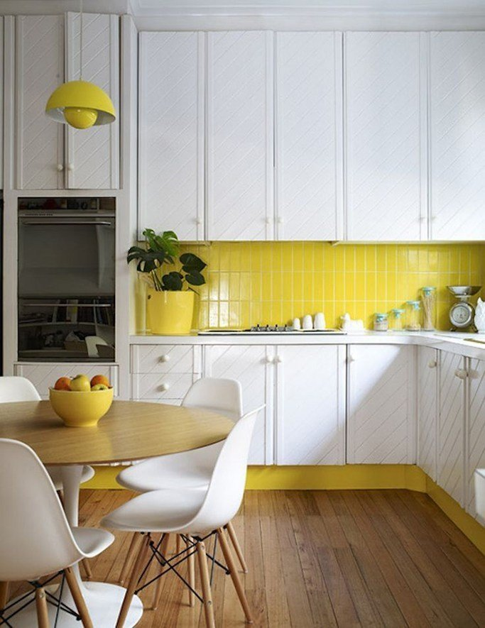 This sunny yellow kitchen successfully mixes vintage charm with mid-century furniture.  Photo 7 of 12 in How the Colors in Your Kitchen Affect Your Appetite