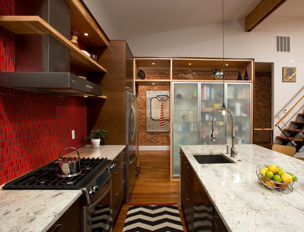 This Washington DC row-house conversion maintains an industrial feel courtesy of brick walls, dark woods and a fiery red backsplash wall. How the Colors in Your Kitchen Affect Your Appetite - Photo 9 of 12