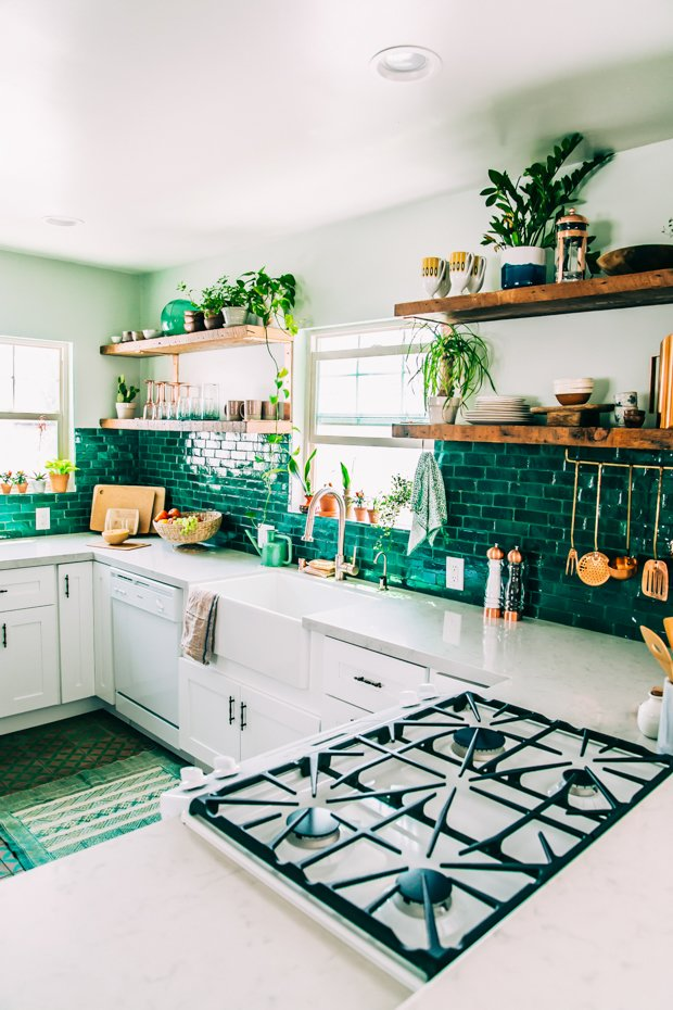 These green tiles are a perfect backdrop for the wealth of potted plants lining the shelves and window sills in this LA artist's kitchen.  Photo 11 of 12 in How the Colors in Your Kitchen Affect Your Appetite