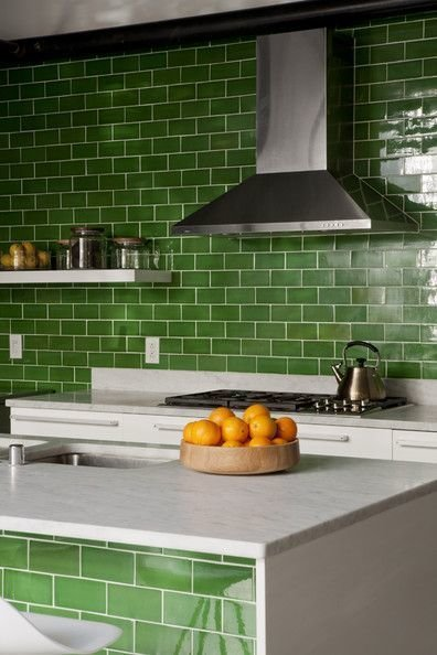 Stem green subway tiles, crisp against white marble countertops, unite this kitchen's island and galley counter. Tagged: Kitchen, Subway Tile Backsplashe, Marble Counter, and White Cabinet.  Photo 12 of 12 in How the Colors in Your Kitchen Affect Your Appetite