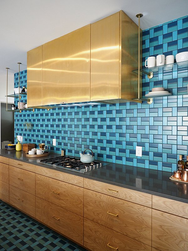 This kitchen, from the 2015 Sunset Idea House, features a pattern of blue & turquoise tiles from the back wall all the way to the kitchen floor. Tagged: Kitchen, Ceramic Tile Backsplashe, Cooktops, Range Hood, and Mosaic Tile Backsplashe.  Photo 4 of 12 in How the Colors in Your Kitchen Affect Your Appetite