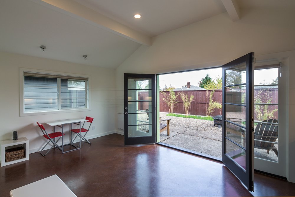 Wide French doors extend the indoors out to a gracious patio and fire pit.  Photo 16 of 16 in 8 Modern In-Law Units