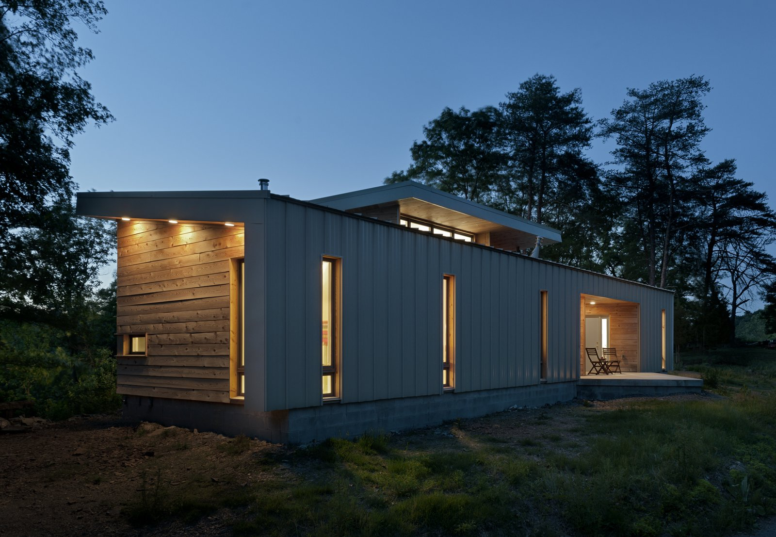 view from the west at dusk  Ridge House by GriD