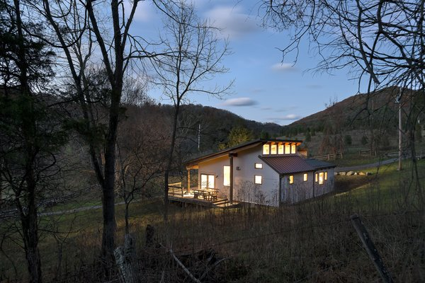 view from the southwest at dusk Photo 19 of Highland House modern home