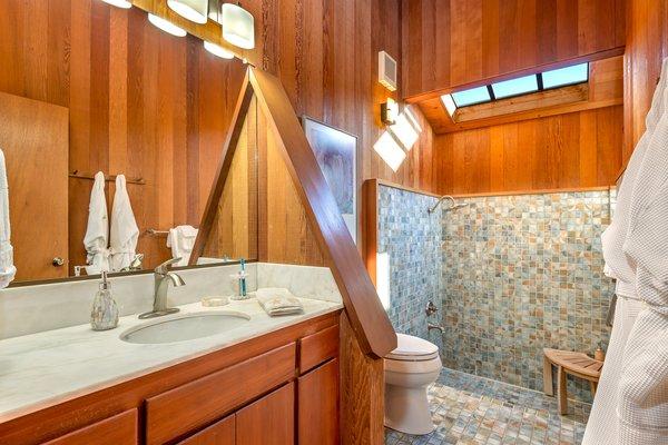 Master bath: Roman tub and rain shower. Clerestory windows around the vaulted ceilings Photo 7 of Abalone Bay modern home