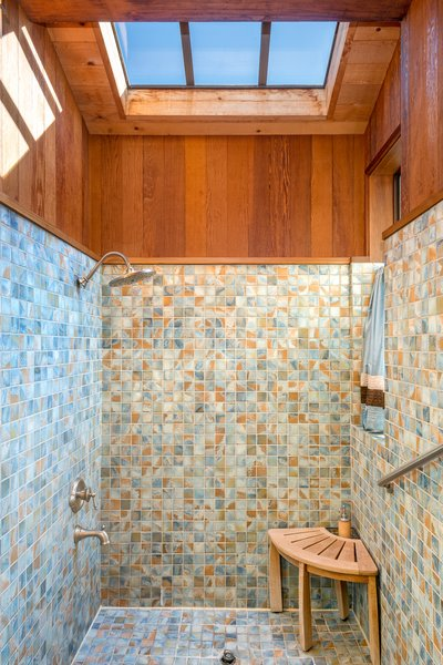Cedar paneling vaulted ceilings rain shower in the Roman tub- recalls the gentle rainstorm among the redwood trail. Photo 9 of Abalone Bay modern home