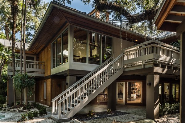 The home seems to sit on stilts, with most living spaces on a second level with cedar batten vaulted ceilings culminating on a clerestory balcony lookout Photo 4 of The Tree House modern home