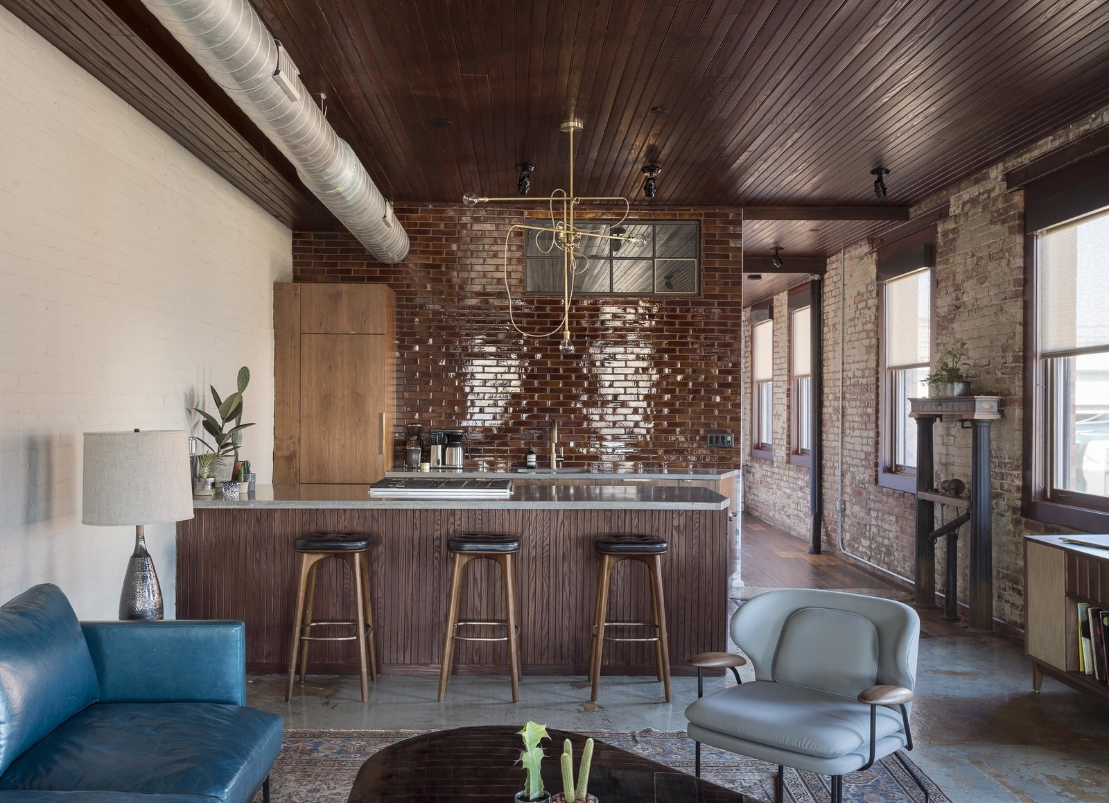 Tagged: Stools, Pendant Lighting, Bar, Concrete Floor, Kitchen, Rug Floor, and Granite Counter.  Mulherin's Hotel by Daniel Olsovsky