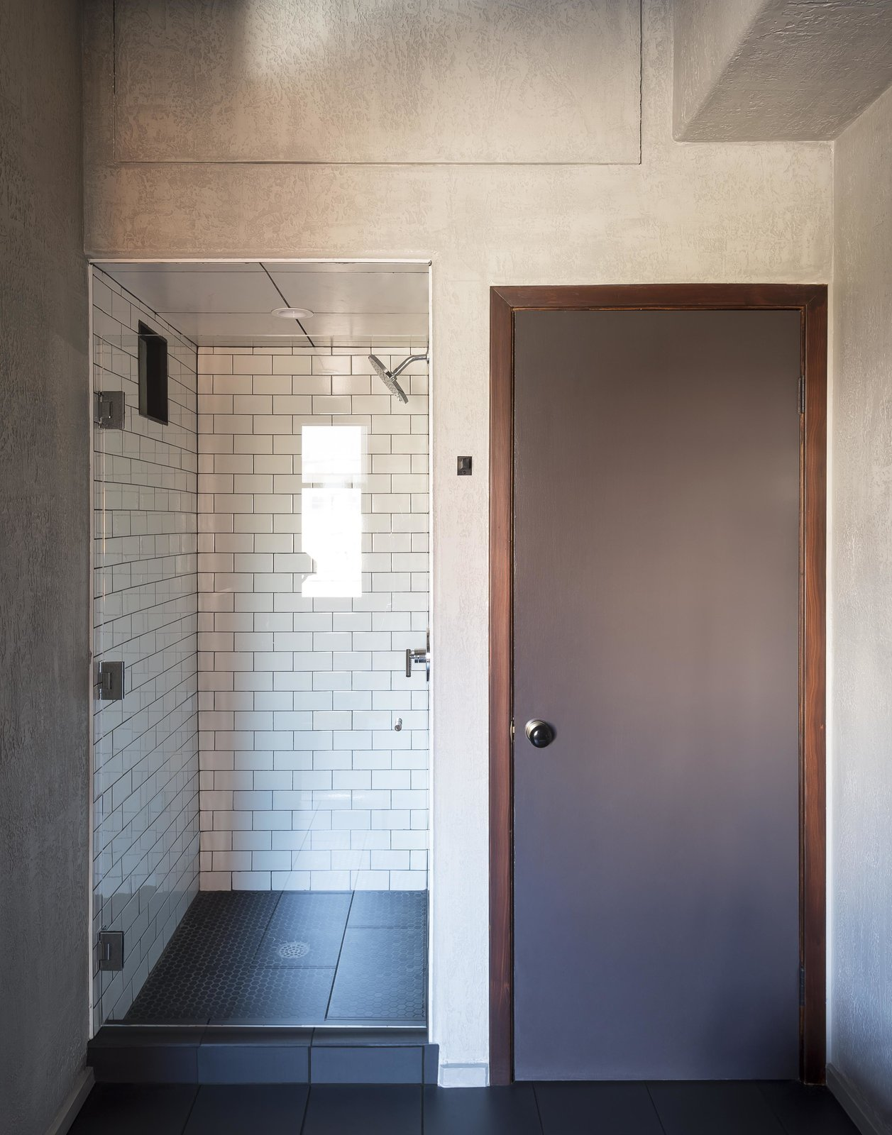 Tagged: Bath Room, Ceiling Lighting, Subway Tile Wall, One Piece Toilet, Enclosed Shower, Ceramic Tile Floor, and Stone Counter.  Mulherin's Hotel by Daniel Olsovsky