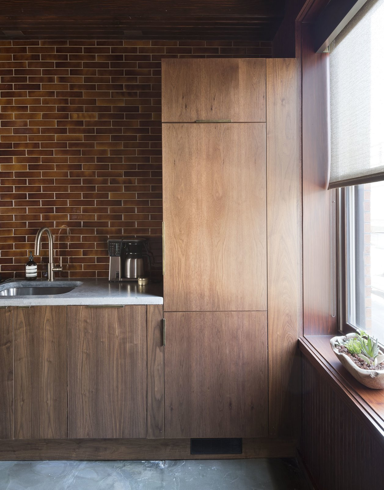 Tagged: Kitchen, Wood Cabinet, Concrete Floor, Granite Counter, Ceramic Tile Backsplashe, Accent Lighting, Drop In Sink, and Refrigerator.  Mulherin's Hotel by Daniel Olsovsky
