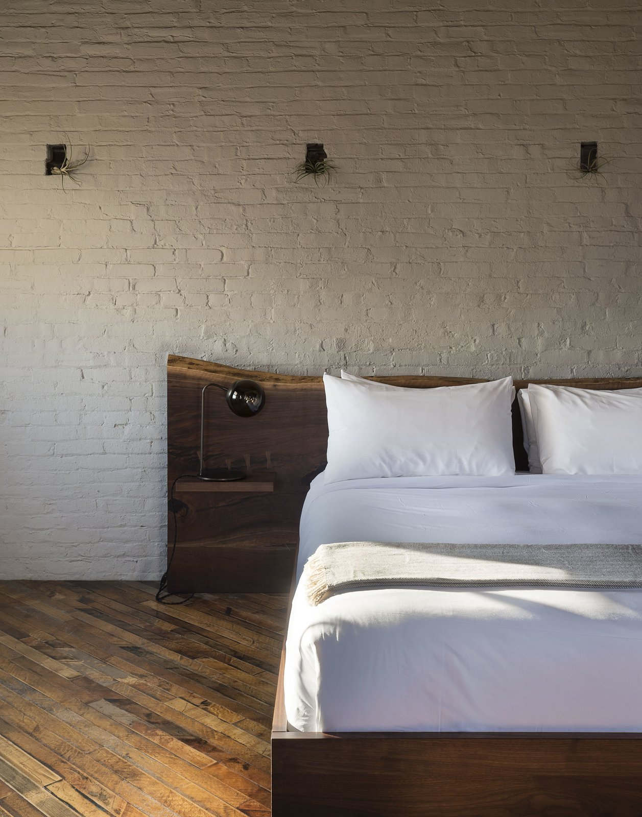 Tagged: Bedroom, Bed, Lamps, and Medium Hardwood Floor.  Mulherin's Hotel by Daniel Olsovsky