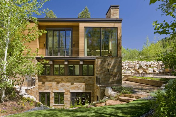 Modern home with outdoor, side yard, metal fence, small patio, porch, deck, stone patio, porch, deck, and wood patio, porch, deck. Exterior  Photo 2 of Ute Rock Residence
