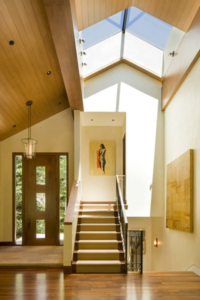 Modern home with staircase, wood railing, and wood tread. Entrence  Photo  of Ute Rock Residence