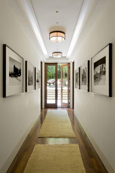 Modern home with hallway and medium hardwood floor. Hallway  Photo 12 of Ute Rock Residence