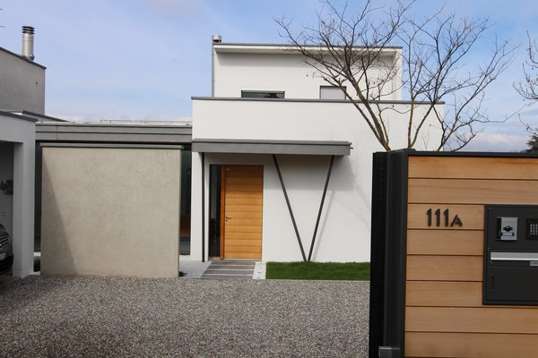 Modern home with doors, wood, exterior, and swing door type. New gate and view to the new entrance Photo 13 of Extension of a house in Geneva