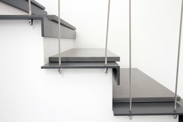 Existing wooden stair transformed into a steel/cement plate stair