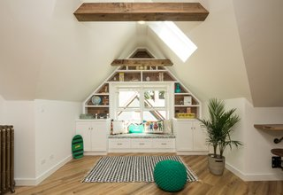 A Modern Attic Renovation:  Home Ec OP Design Studio and Lounge - Photo 3 of 4 - The skylight illuminates the nook for reading and lounging.