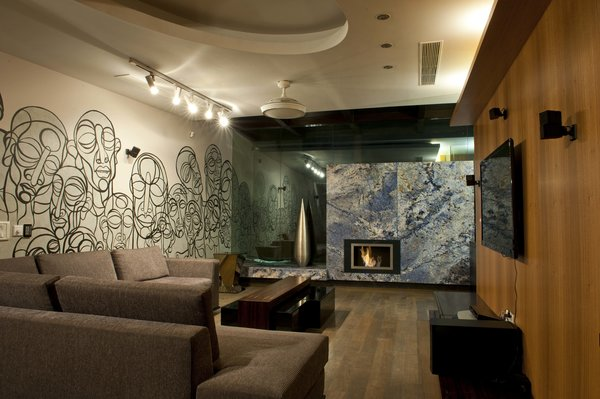 The wall in the terrace bar, which houses its own cosy fireplace, are feverishly done up in a custom mural. Photo 5 of In the details modern home