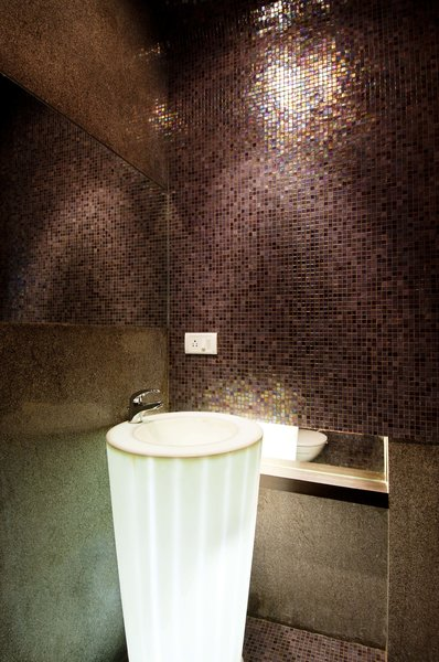 The costume made self illuminated basin, surrounded by shinny bronze tiles. Photo 6 of In the details modern home
