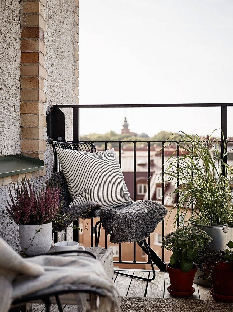 Small outdoor spaces carry big impact. Use patios and balconies to extend square footage in the city.  Photo 8 of 10 in 10 Ways to Use Rugs in Your Outdoor Space This Spring