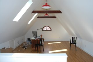 The skylights that descend into the wall plane bring in natural light and provide views of the historic neighborhood.