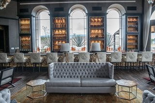 One of the interior sitting rooms at La Casona; the space feature marble tables and bar tops from Marble Gris Coral and Marble Veracruz from Puebla, Mexico.