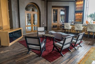 The floors are made from reclaimed wood found in the local region; the chairs are upholstered in American and Spanish textiles.