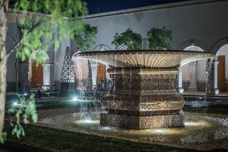 Patrón Designed a Spanish Colonial Guest House with Modern Flair - Photo 14 of 14 - The outdoor water feature does double duty; it also serves as a water replenishment well for plants and vegetation.