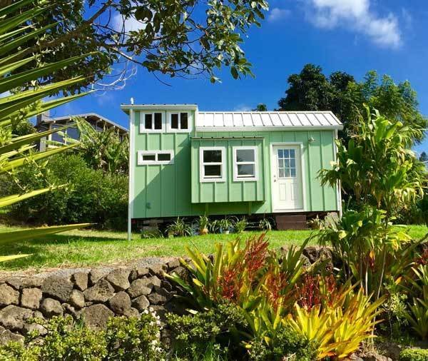 This custom-built hut by Habitats Hawaii can sleep five people. There's a single bench/bed in the kitchen and a window bump-out bed with a double punee' downstairs. The main bedroom boasts a queen bed in the loft.