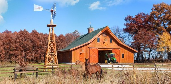The Ponderosa Country Barn by Sand Creek Post & Beam features 12-foot closed lean-tos. All of their wood barn kits feature the strength and beauty of post-and-beam timber frame construction.