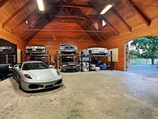 10 Prefab Garage Solutions For Auto Enthusiasts - Photo 1 of 10 - How about a customized barn to house that prized classic car collection? Barn Pros can set you up with a wide variety of barn building packages including everything from blueprints (you could pay up to $30,000 for those alone) to lumber and hardware—the only materials not included are nails, concrete, and the final layer of roofing.