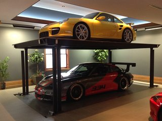 10 Prefab Garage Solutions For Auto Enthusiasts - Photo 7 of 10 - Add an extra Porsche with a custom residential car lift by American Custom Lifts, designers of the first and only American-made, single-post car lift for storing two vehicles in the parking space of one.